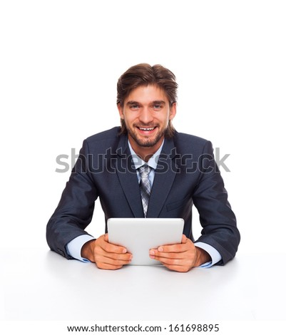 businessman smile working using tablet pad computer, handsome young businessman sitting at the desk wear elegant suit, isolated over white background - stock photo