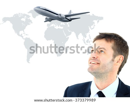 businessman smileeng and looking at airplane - stock photo