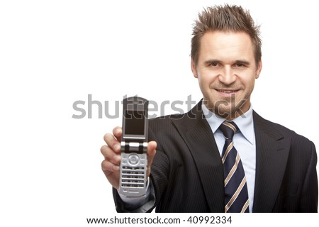 Businessman smiles and shows his mobile phone into camera. Isolated on white. - stock photo