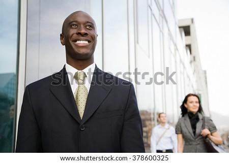 Businessman smiling - stock photo