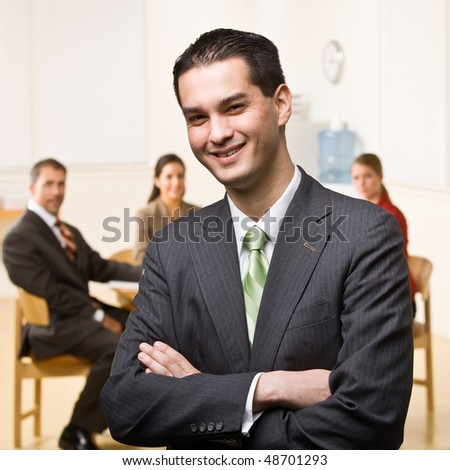 Businessman smiling - stock photo