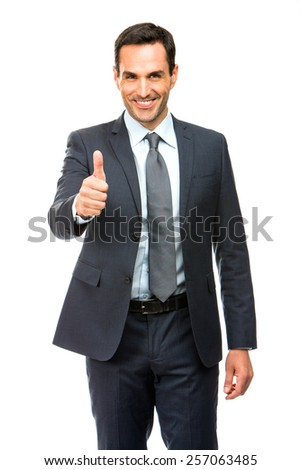Businessman smiling and giving ok with one hand - stock photo