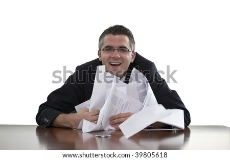 Businessman smiling and holding sheets of paper or documents (white background)