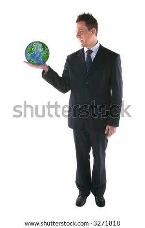Businessman smiling at a globe in his hand,isolated on white.Globe from NASA images.