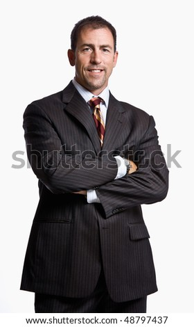 Businessman smiling with arms crossed - stock photo