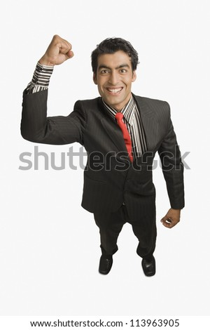 Businessman smiling with his hand raised
