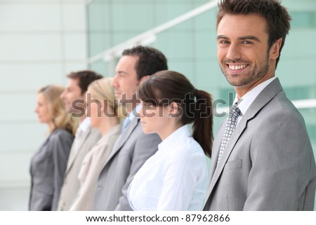 businessman smiling with team - stock photo