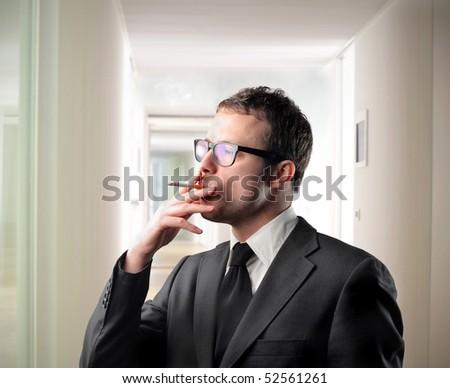 Businessman smoking - stock photo