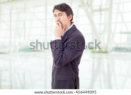businessman smoking at the office - stock photo