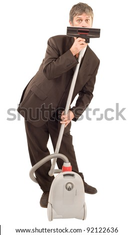 Businessman speak through vacuum cleaner isolated on white background - stock photo