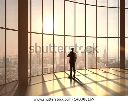 businessman speaking at sunset office - stock photo