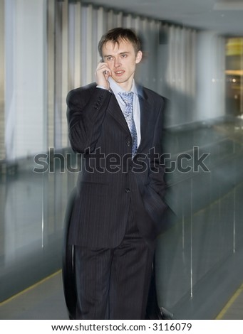 businessman speaking by the phone with effect motion blur