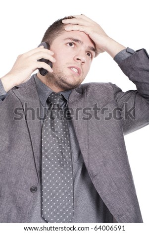 businessman speaking on the phone and looking worried - stock photo