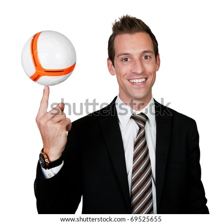 Businessman spinning soccer ball - stock photo