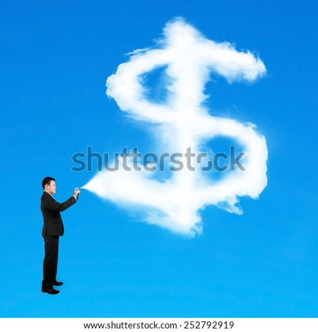 Businessman spraying dollar sign shape cloud paint isolated on blue background