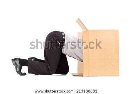Businessman squeezing himself into a box isolated on white background - stock photo
