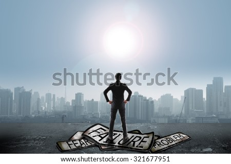 Businessman stand on problem traffic sign looking at sun, success concept - stock photo