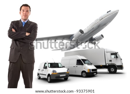 Businessman standing against a transportation fleet - stock photo