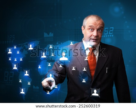 Businessman standing and choosing from social network map - stock photo