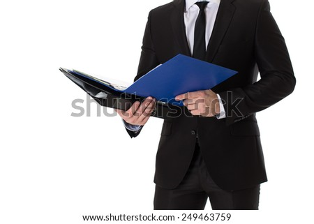 Businessman standing and holding a file folder. Isolated on white background. - stock photo