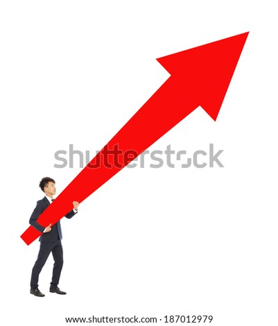 businessman standing and holding a upward red arrow - stock photo