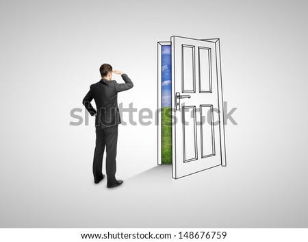 businessman standing and looking at drawing door