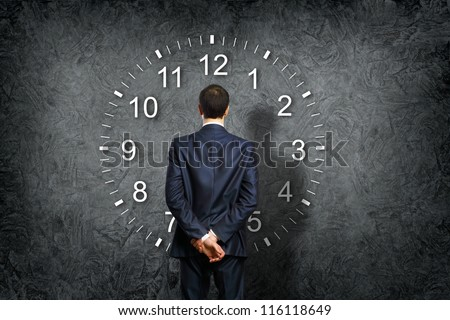 Businessman standing and making his choice between times - stock photo