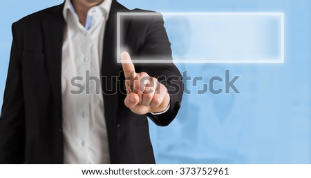 Businessman standing and pointing against blue background