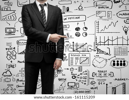 businessman standing and showing  finger to business strategy