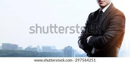 businessman standing and thinking on buildings backgrounds - stock photo