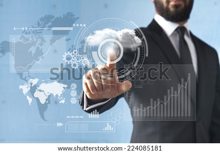 Businessman standing and working with touch screen technology - stock photo