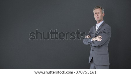 Businessman standing arms crossed over white background against grey background - stock photo