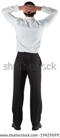Businessman standing back to the camera with hands on head on white background