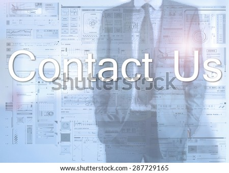 Businessman standing behind transparent board with diagrams and text Contact Us - stock photo