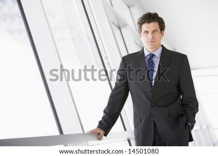 Businessman standing in corridor - stock photo