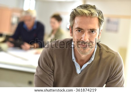 Businessman standing in design office