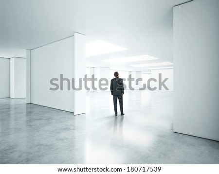 Businessman standing in empty white office