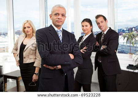 Businessman standing in front - stock photo