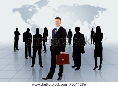 Businessman standing in front of an earth map - stock photo