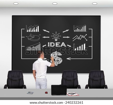 businessman standing in office and drawing business scheme - stock photo