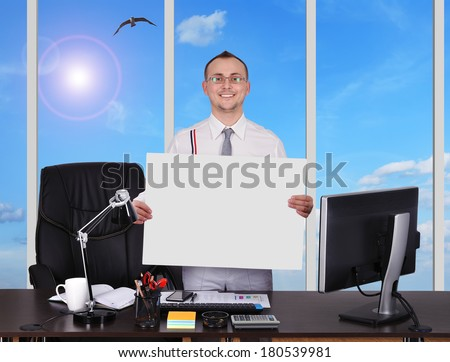businessman standing in office and holding  placard - stock photo