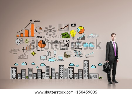 businessman standing in office with drawing  business concept on wall - stock photo