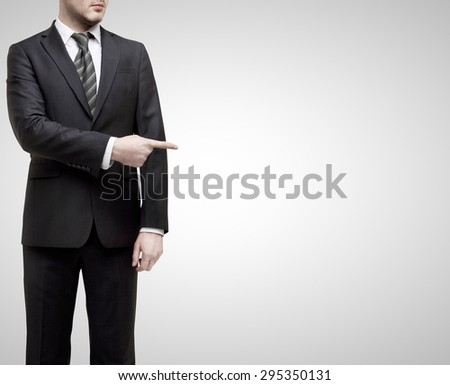 businessman standing in suit and shows finger to something - stock photo