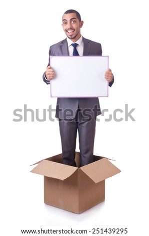 Businessman standing in the box isolated on white - stock photo