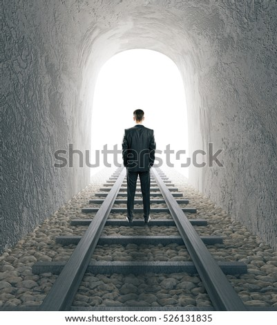 Businessman standing in the middle of railway tunnel. 3D Rendering
