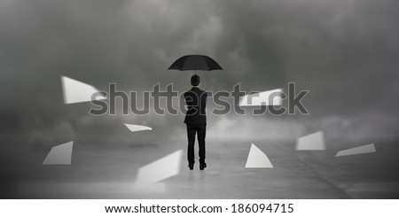 businessman standing in the Monsoon - stock photo