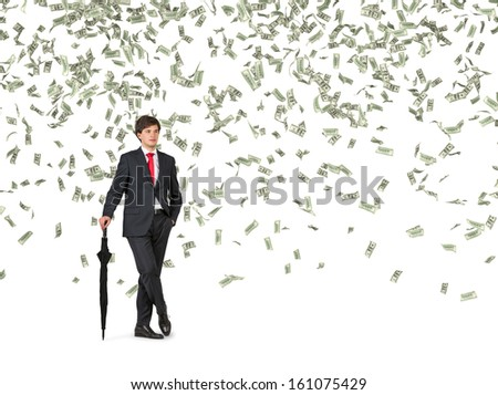Businessman standing in the rain of money. - stock photo