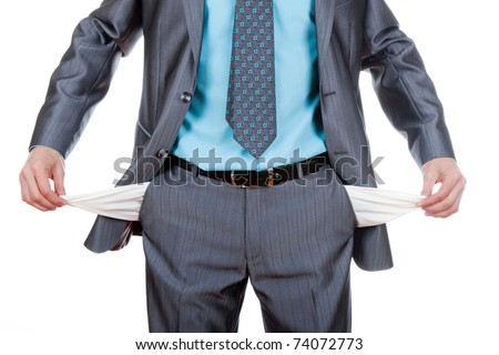 businessman standing isolated on the white background and showing his empty pocket, turning his pocket inside out, no money