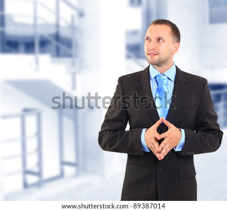 Businessman standing, looking off into distance - stock photo