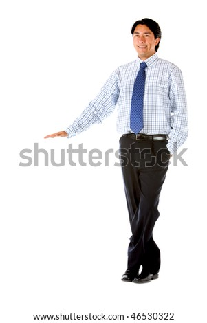 Businessman standing next to an imaginary object isolated over white